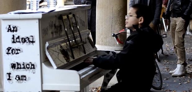 George Harliono plays piano in public