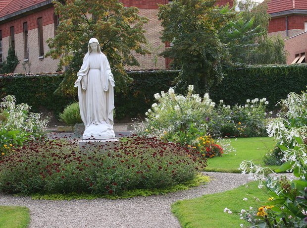 flowers and virgin mary