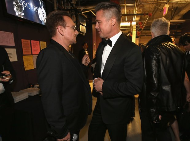 Bono of U2 and Brad Pitt Oscars 2014 backstage