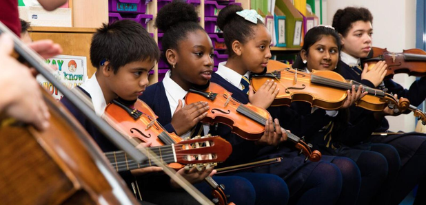 children playing string instruments